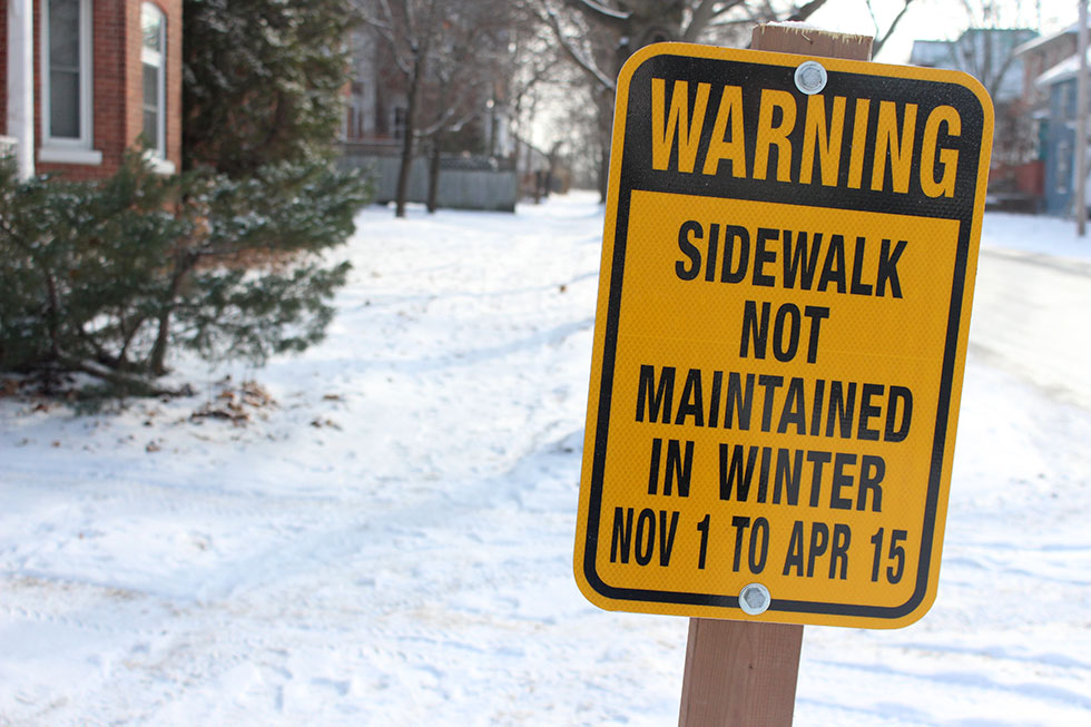 Signs going up on sidewalks that aren't maintained through winter