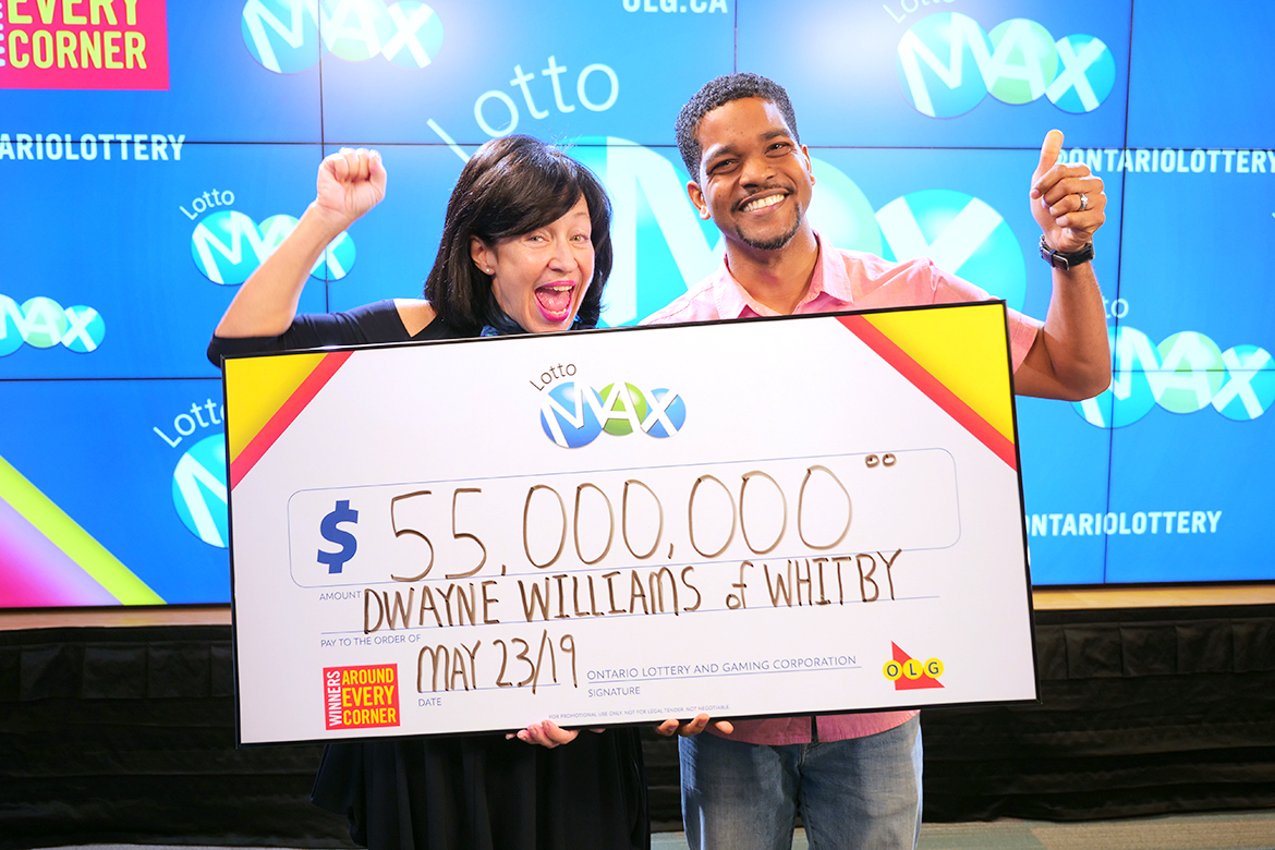 Whitby man collects $55 million for lottery win