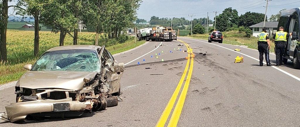 Highway 12 closed after collision between passenger vehicle and water truck