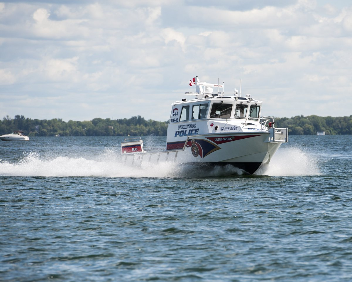 Officers rescue three people on Lake Simcoe after boat capsizes